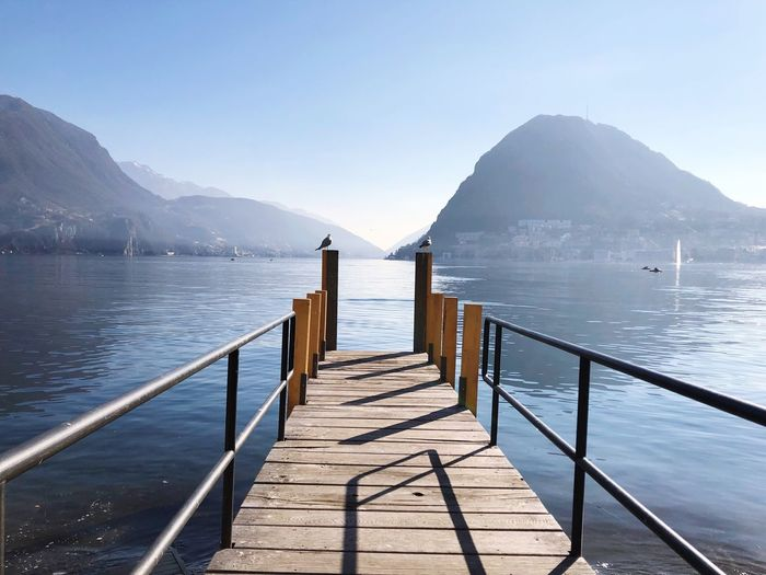 lake Water Scenics - Nature Mountain Tranquility Wood - Material Beauty In Nature Railing Pier Day Sky No People Mountain Range Nature Tranquil Scene