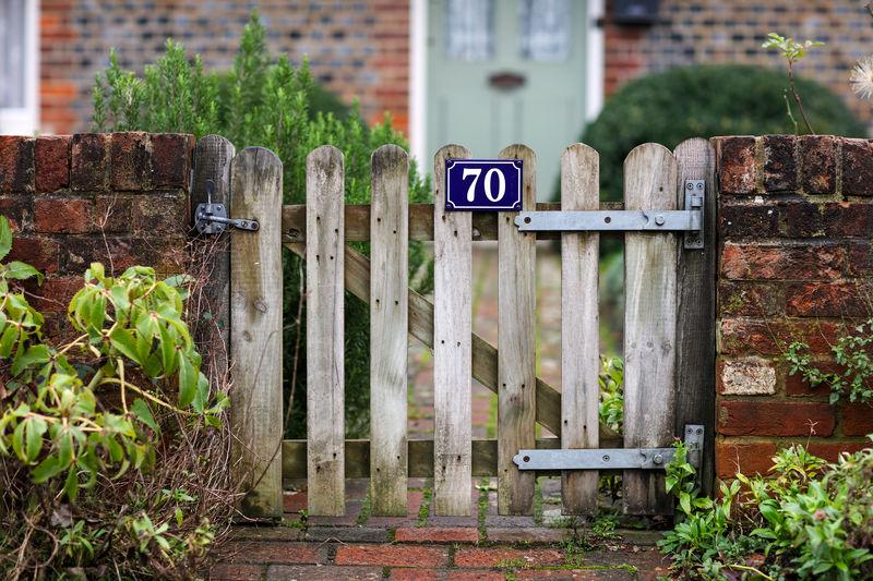 Garden gate Alresford Alresford, UK Front Gate Garden Gate Gardengate 70 Wooden Gate Brick Wall Home Village Urban Day Outdoors Barrier Building Exterior