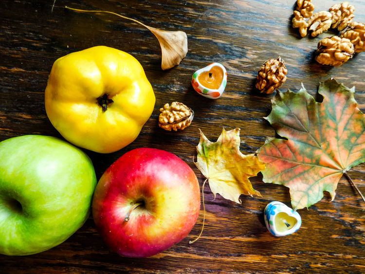 Autumn decoration Apple Autumn Nuts Table Setting Close-up Decoration Food Food And Drink Freshness Fruit Healthy Eating High Angle View Indoors  Leaf No People Nut - Food Quince Table Wooden Yellow
