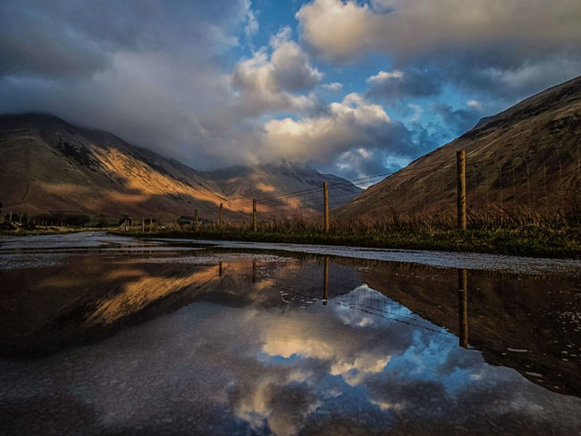Pole position. Reflection No People Beauty In Nature Outdoors Sunshine Nature Sky And Clouds Multi Colored England🇬🇧 United Kingdom Great Britain Europe Wast Water Lake District Lake Water Nature Nature_collection Moody Mountains Mountain Range Shadows & Lights Scenics Sky Day