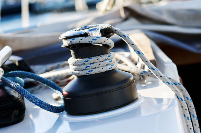 Winch with rope on sailing boat Marina Mediterranean Sea Rope Adventure Boat Close-up Cord Crank Cranky Day Deck Fixed Mast Nautical Nautical Vessel No People Nobody Rigging Sail Sailboat Sailing Sea Vessel Yacht Yachting