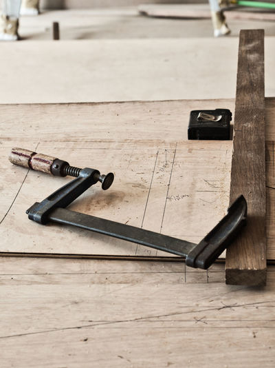 Wood - Material Indoors  Table High Angle View Still Life Focus On Foreground Tool Close-up Hand Tool Work Tool Equipment Technology Flooring Pen Hammer Man Made Wood Black Color Metal Backgrounds Carpenter Woodworking Single Object Group Of Objects Craft