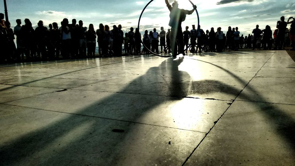 Perfomance People Crowd Show Circle Daylight Plaza Friends Sillouette Getting Inspired Acrobatics  Street Artist TakeoverMusic Adapted To The City Uniqueness The City Light The Portraitist - 2017 EyeEm Awards The Street Photographer - 2017 EyeEm Awards