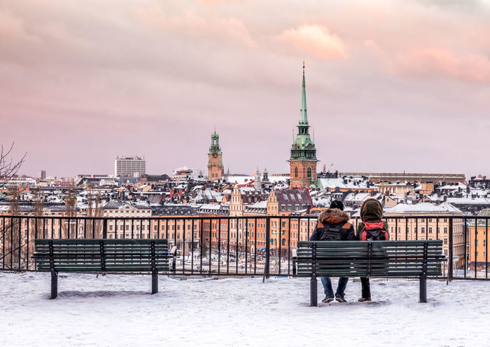 Lovers at the hill of Sodermalm looking over the Stockholm Old Town (Gamla Stan). This winter was relatively warm but finally the season for snow has come here. Buildings are covered with snow and a bit early afternoon from 2.30 pm, you can enjoy lovely sunset if you are lucky. Architecture Built Structure Design Destination Gamla Stan Hill Holidays Lovers Old Town Outdoors Scandinavia Season  Sky Sky Lines Skyporn Snow Snow ❄ Sunset Sweden Södermalm Stockholm Travel Travel Photography Vintage Winter First Eyeem Photo
