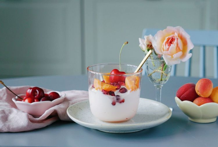 Ice cream and fruits in bowl on table