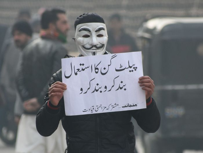 A protester holds a placard reading Stop use of pellet gun .During clashes at jamia masjid on December 21, 2018. demonstrate against the killing of seven civilians by security forces in south Kashmir's Pulwama on December 15. Kashmir , India Srinagar Kashmir Protesters Clashes Men Placard Protest
