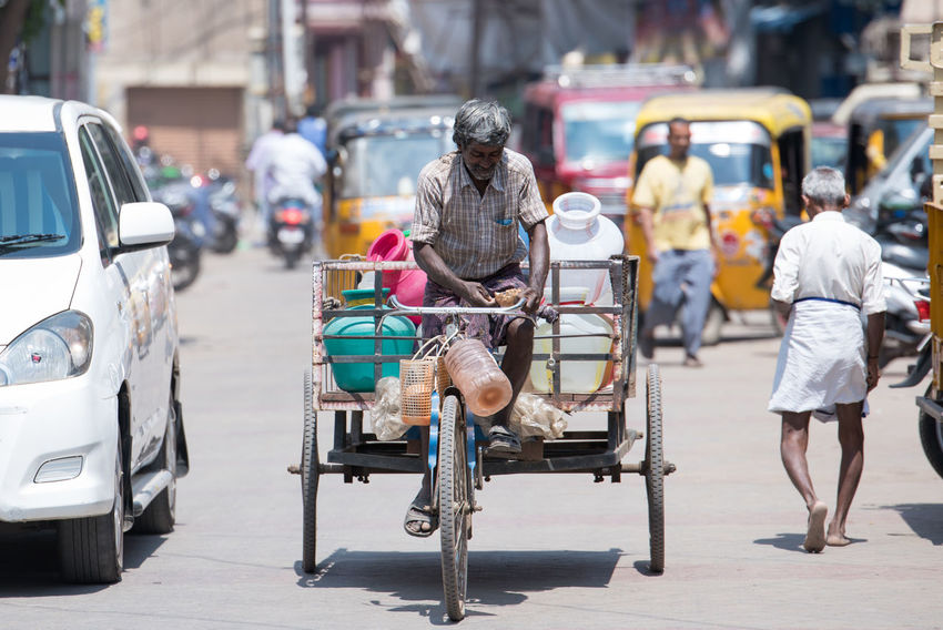 Asian Culture Bike City City Life Cycling Day Focus On Foreground Full Length Hardwork Indiapictures Labour Land Vehicle Mammal Men Mode Of Transport One Person Outdoors Real People Rear View Rikshaw Road Street Traffic Transportation Women