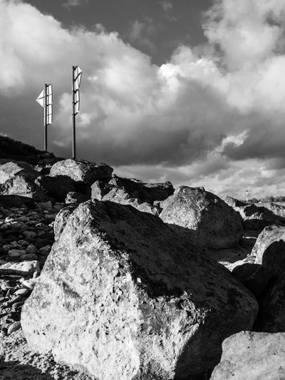 Black And White Cloud - Sky Day Low Angle View Nature Outdoors Rocks Signpost Sky