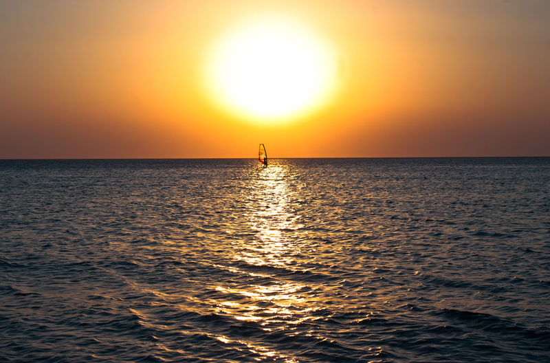 Sunset windsurfing at Falassarna beach, Crete Crete Greece Crete Island Adventure Beauty In Nature Falassarna Greekislands Horizon Over Water Idyllic Paradise Reflection Sea Silhouette Sports Sun Sunlight Sunset Travel Destinations Vacations Waterfront Windsurfing