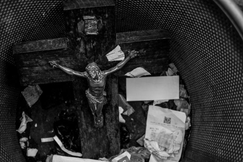 High Angle View Of Crucifix In Garbage Bin