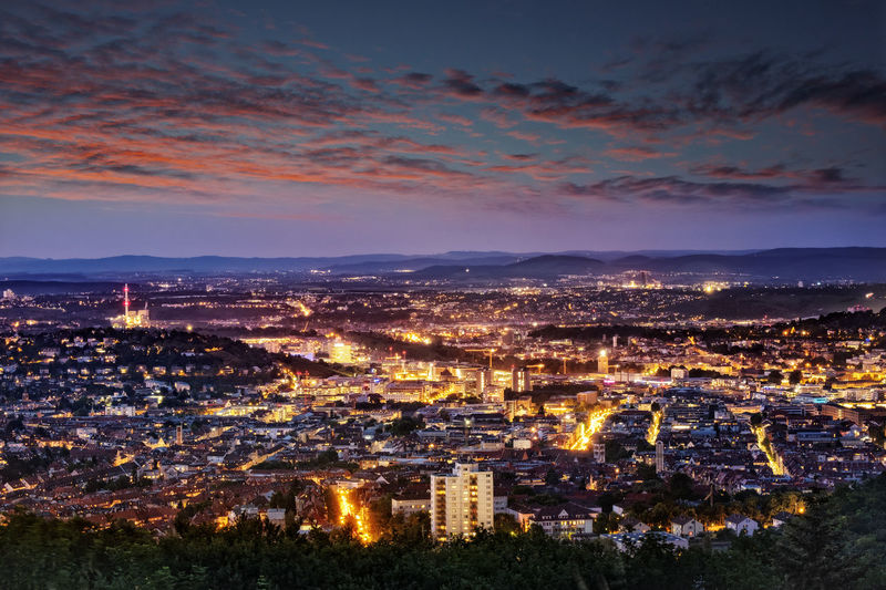 Evening shot of Stuttgart, Germany, taken from Birkenkopf view point. City Building Exterior Architecture Cityscape Cloud - Sky Built Structure Sky Illuminated Residential District Building High Angle View Nature Night Dusk City Life Aerial View Travel Destinations Outdoors Office Building Exterior Skyscraper Stuttgart Baden-Württemberg  Germany Sunset Cityscape