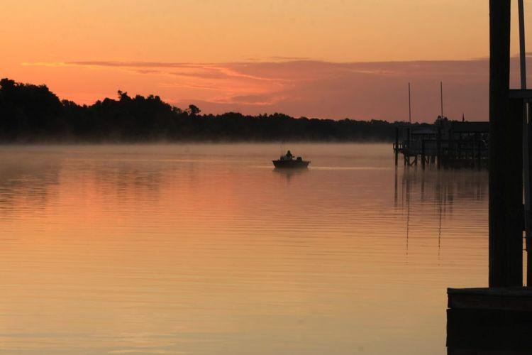 Small boat on the intercoastal waterway oak island north carolina