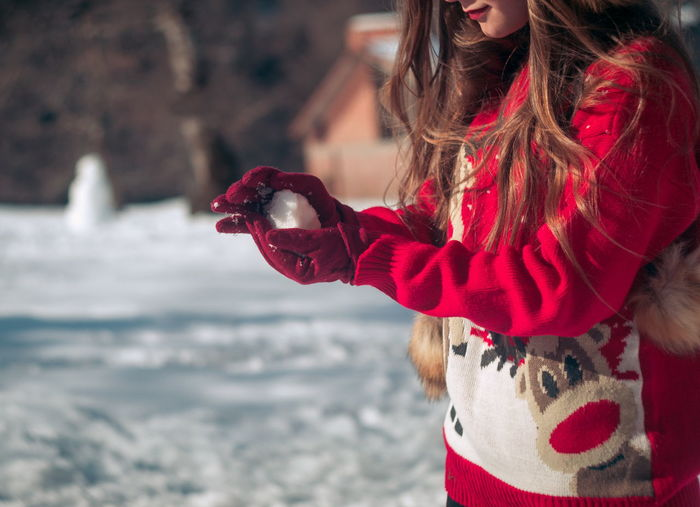 Water Long Hair Hair One Person Women Hairstyle Sea Child Focus On Foreground Red Day Nature Girls Clothing Childhood Leisure Activity Holding Females Outdoors Warm Clothing Hand