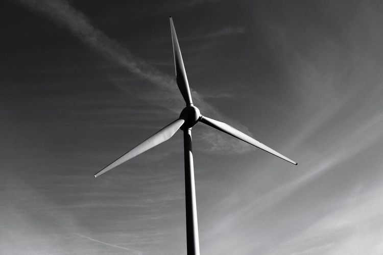 Low angle view of wind turbine against sky