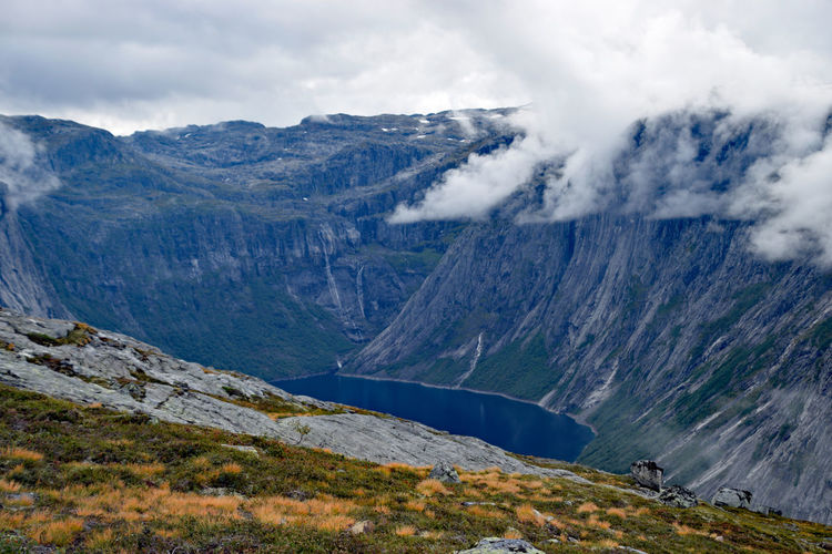 View along Trolltunga hike Norway Beauty In Nature Cloud - Sky Day Environment Land Landscape Mountain Mountain Peak Mountain Range Nature No People Non-urban Scene Outdoors Remote Scenics - Nature Sky Tranquil Scene Tranquility Trolltunga Norway Hiking Valley Water
