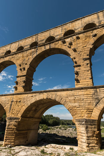 Aqueduct Arch Architecture Bridge - Man Made Structure Built Structure Connection Day France History Low Angle View Nature No People Old Ruin Outdoors Pont Du Gard Provence Provence-Alpes-Cote D'Azur Sky Sunlight