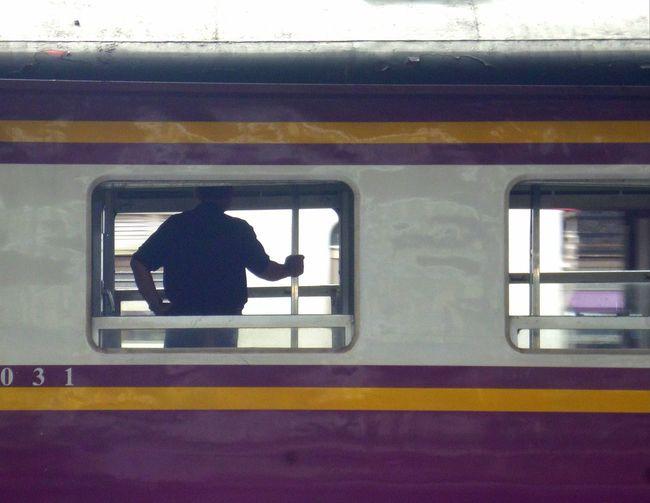 Man and train at railroad station platform