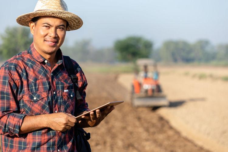 Portrait of man working on field