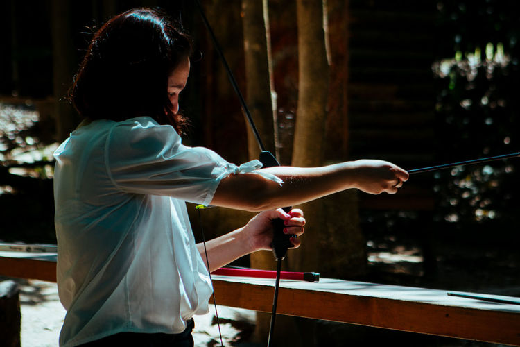 Woman bow and arrow shooting