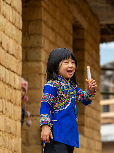 Childhood Child Real People Innocence Portrait Architecture Casual Clothing Leisure Activity Rural Scene Girls Standing Smiling Happiness Lifestyles Ice Cream Yunnan Ethnicwear
