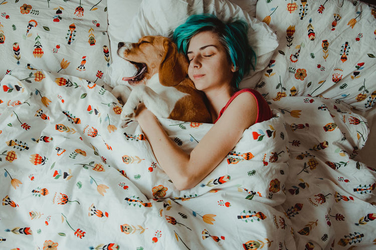 Nuca the beagle and her girlfriend, in the morning Indoors  Bed Furniture One Animal Pets Domestic Animals Relaxation Mammal Resting Vertebrate Canine Floral Pattern Lying Down Animal Themes Animal Sleeping Eyes Closed  Lifestyles Morning Morning Light Morning Rituals Love Girls IKEA Blue Hair My Best Photo