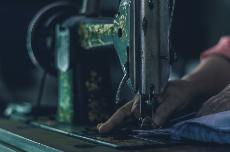 Close-up Equipment Finger Focus On Foreground Hand Human Body Part Human Hand Indoors  Machine Part Machinery Men Metal Occupation One Person Real People Sewing Sewing Machine Skill  Tailor Technology Working