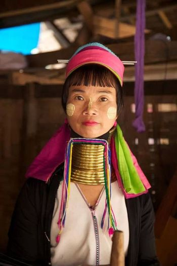 Stretched neck. Culture Travel Colorful