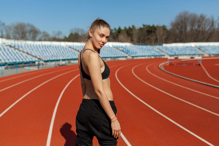 Woman exercising on sports track