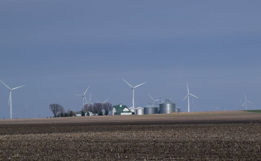 Wind Power in Northwestern Indiana Agriculture Alternative Energy Clear Sky Day Environmental Conservation Environmental Issues Fuel And Power Generation Nature No People Outdoors Renewable Energy Rural Scene Sky Social Issues Solar Panel Sustainable Resources Tree Wind Power Wind Turbine Windmill