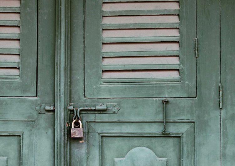 FULL FRAME SHOT OF LOCKED DOOR OF HOUSE