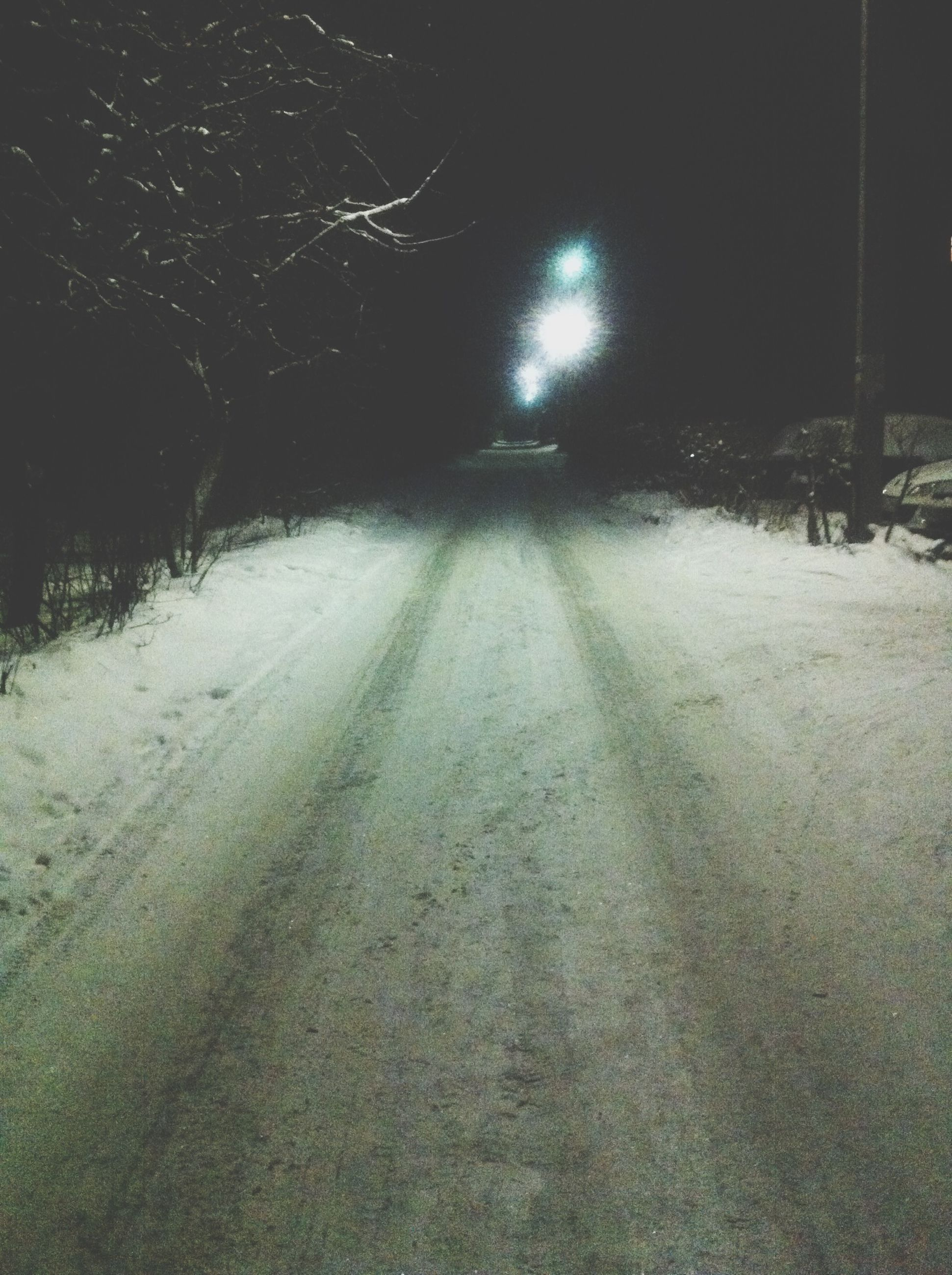 night, the way forward, illuminated, snow, winter, cold temperature, street light, transportation, road, street, weather, diminishing perspective, tree, season, lighting equipment, vanishing point, outdoors, nature, empty, no people
