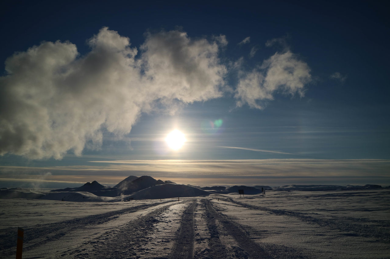 nature, scenics, snow, sky, cold temperature, weather, tranquil scene, beauty in nature, tranquility, winter, no people, landscape, outdoors, the way forward, cloud - sky, road, tire track, transportation, day