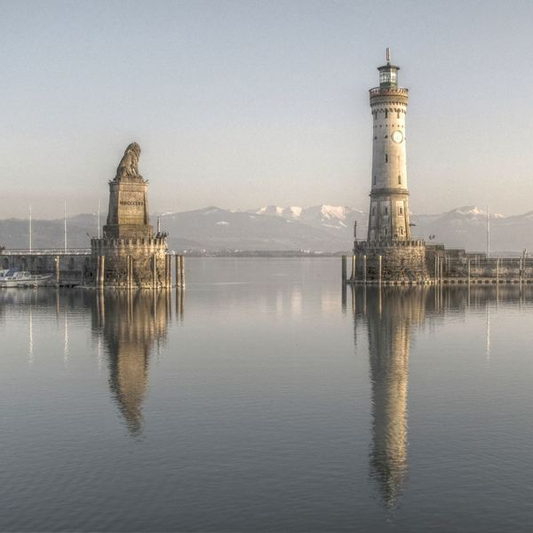 Port of Lindau, Lake Constance. Lindau Lion Alps Architecture Beauty In Nature Bodensee Building Exterior Built Structure Constance Day Lake Lighthouse Mountains Nature No People Outdoors Reflection Scenics Sea Sky Tower Tranquility Water