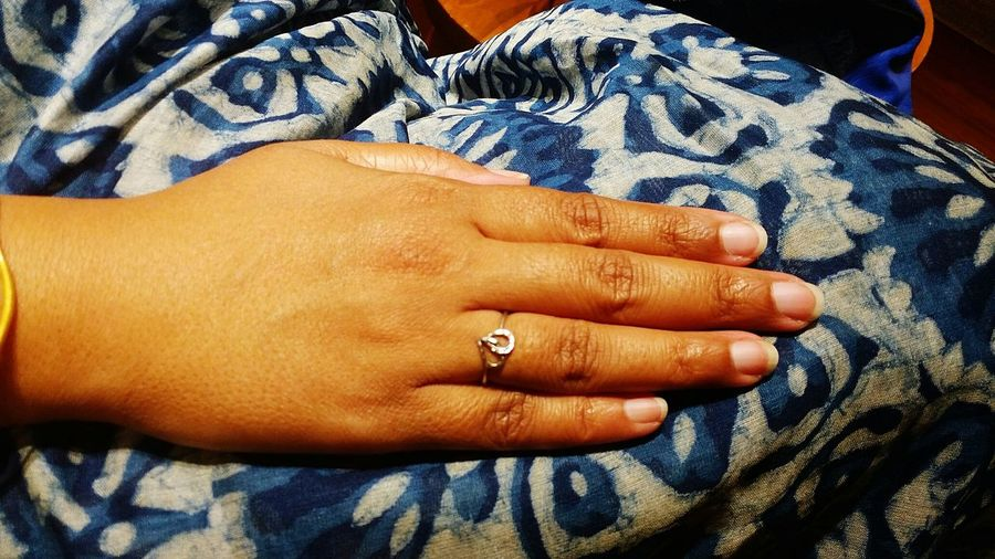 Cropped Image Of Woman Showing Engagement Ring