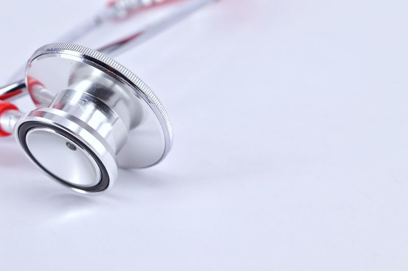 High Angle View Of Stethoscope On White Background