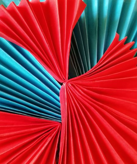 Close-up of red and blue paper for art