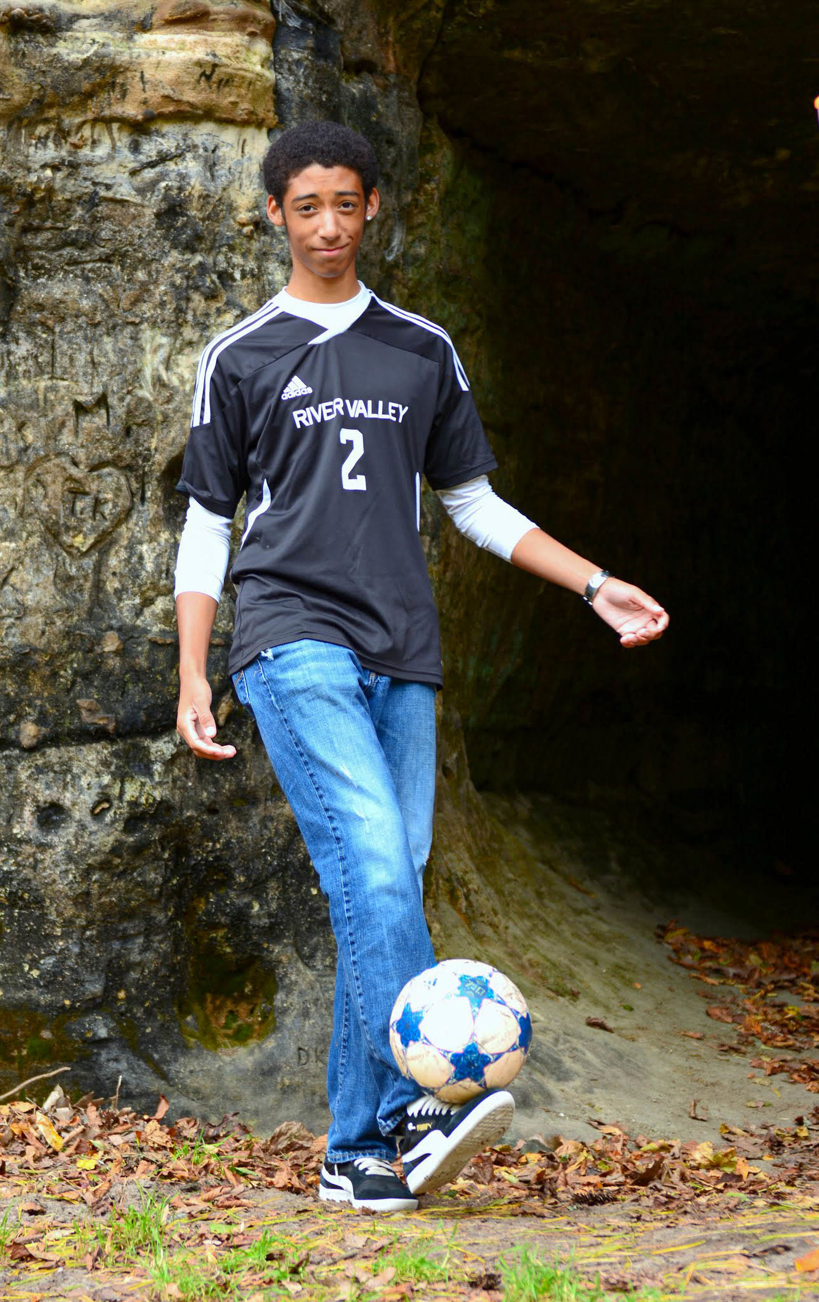 one person, soccer, soccer ball, ball, full length, casual clothing, team sport, sport, sports equipment, real people, men, front view, day, nature, young adult, leisure activity, looking at camera, males, portrait, teenager, jeans