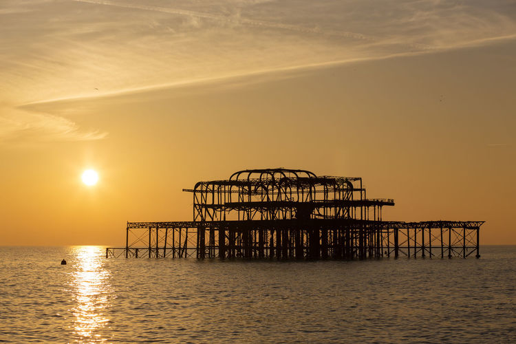 The ruins of Brighton's famous West Pier, UK, on a beautiful winter day Brighton Orange Color Sunset West Pier Pier Sky Sea Water Architecture Built Structure No People Beauty In Nature Nature Tranquility England Ocean