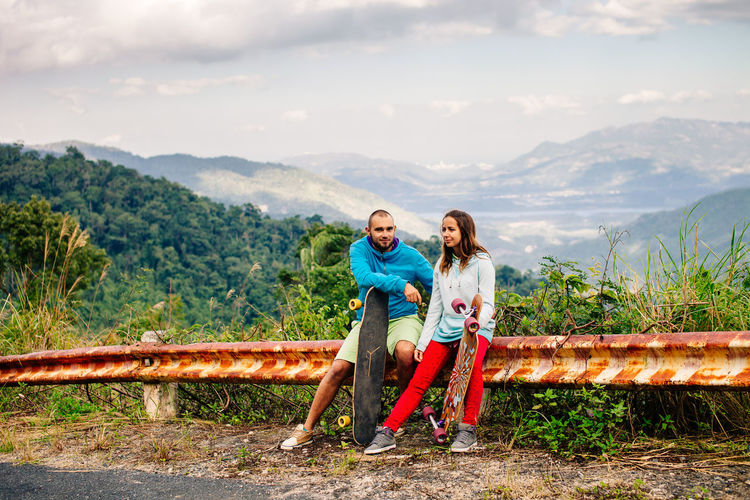 longboarding and skateboarding couple in mountains. Extreme and active lifestyle. ASIA Couple Dating Extreme EyeEm Best Shots EyeEm Gallery Happy Longboard Longboardlife Love Relationship Skateboarding Summertime Vietnam Active Lifestyle  Couple - Relationship Hipster Longboard Girl Longboarding Mountain Summer