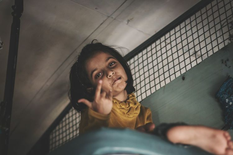 Kids being hiphop fans 😍😅 One Person People Portrait Human Body Part Human Hand Kids Style Train Interior Low Light India Tadaa Community EyeEm Best Shots Taking Photos Tamilnadu Chennai Girl Travel Transportation Journey Pose Candid Babygirl Lifestyles Casual Clothing Traveling Home For The Holidays Women Around The World The Portraitist - 2017 EyeEm Awards