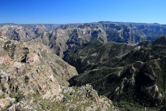 Mountainous landscapes of Copper Canyons in Chihuahua, Mexico Canyons Cliffs Creel Mexico Natural Panorama Panoramic Rural South Tourist Travel View America Attraction Canyon Chihuahua Copper  Hill Landmark Landscape Mountain Mountains Rocks Sky Tourism
