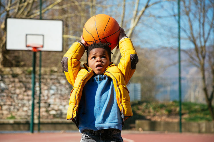 African Autumn Little Boy Winter Basketball - Ball Basketball - Sport Black Boys Challenge Child Childhood Close-up Court Difficult Front View Innocence Leisure Activity Males  Offspring One Person Outdoors Playing Real People School Sport
