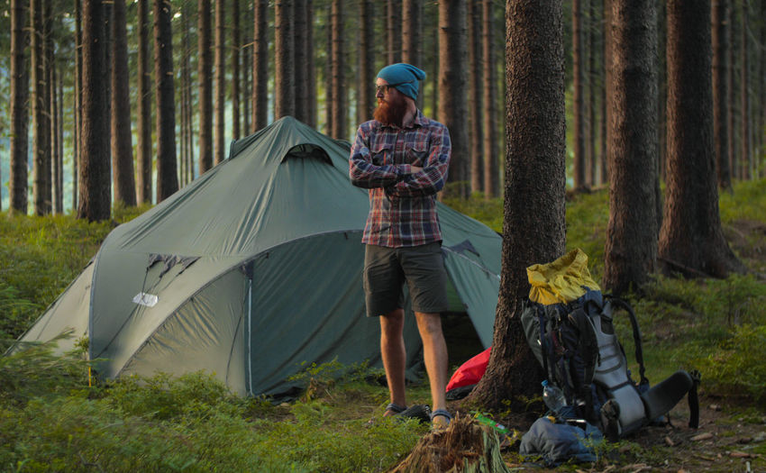 Man Camping In Forest