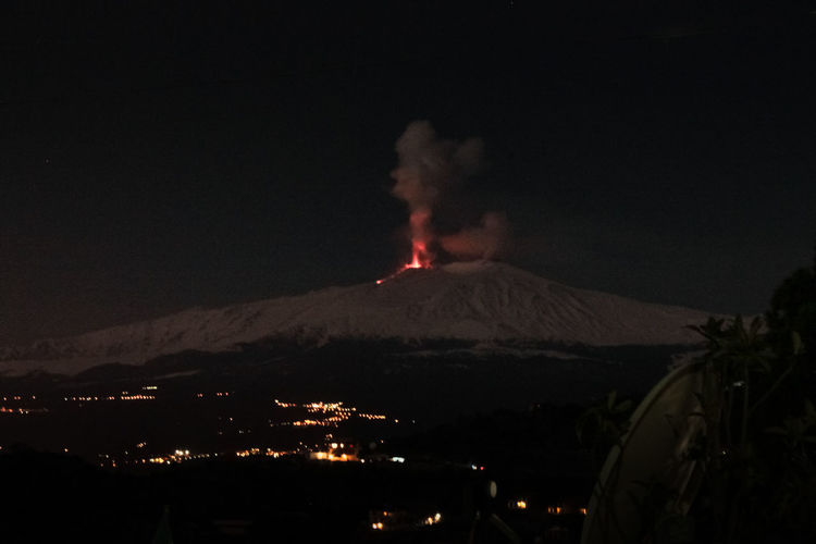 Catania Mountain Volcano Night Smoke - Physical Structure Erupting Geology Power In Nature Lava Power Environment Heat - Temperature Nature Burning Communication Sign Warning Sign Fire Beauty In Nature Land Active Volcano No People Outdoors Volcanic Crater Pollution Air Pollution