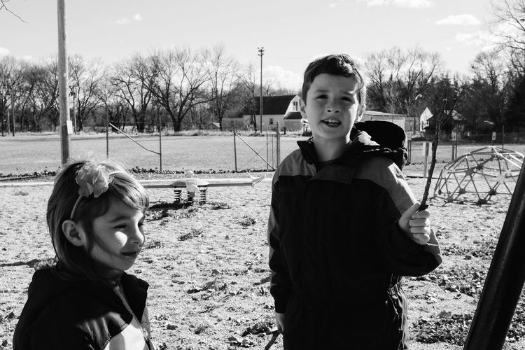 Siblings standing in playground