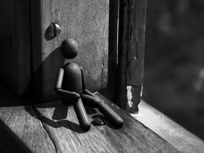 A computer generated puppet rendered in Cinema 4D looks out an old window near Guelph, Ontario. 3D Black & White Black And White Blackandwhite CINEMA4D Close-up Composite Contrast Detail Focus On Foreground Light And Shadow Photo Manipulation Photoshop Portrait Puppet Shadow Still Life Surreal Window Wood