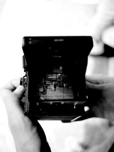 Close-up of hand holding camera