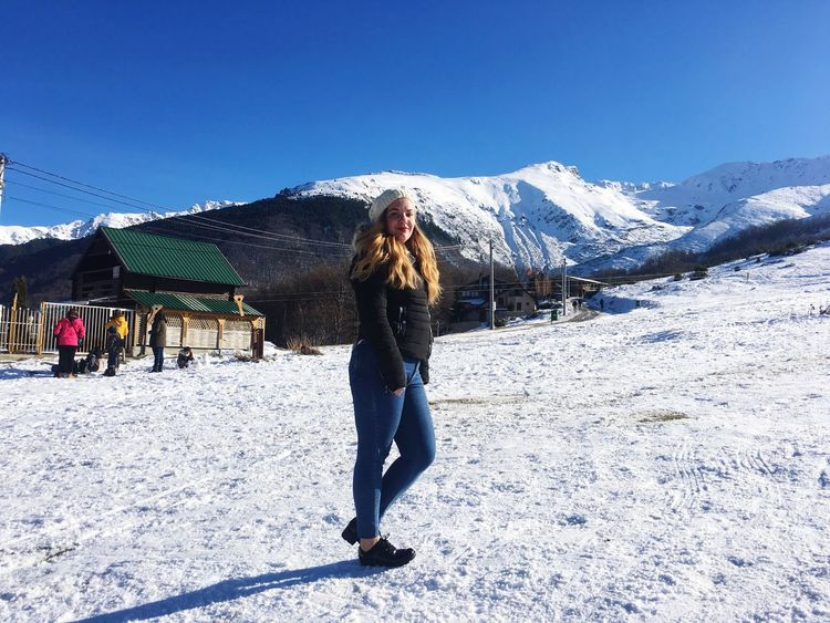 EyeEmNewHere White Snow Winter Cold Temperature Full Length Real People Front View Mountain One Person Clear Sky Day Sunlight Outdoors Looking At Camera Leisure Activity Lifestyles Nature Blue Standing Vacations Portrait