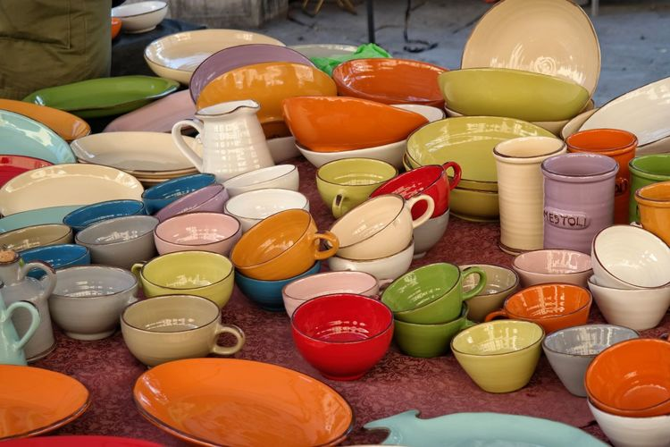 Colorful crockery on table