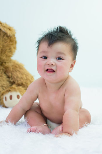 Portrait of cute baby on bed